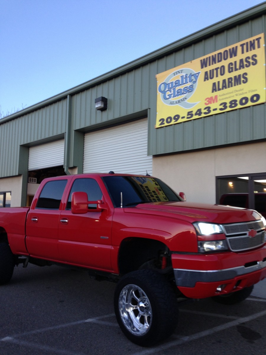 Red Chevy truck with vehicle window tinting (1)