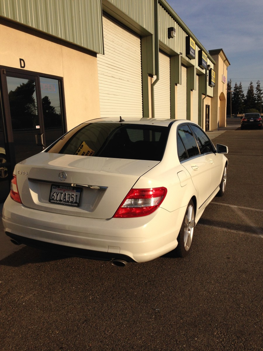 White Mercedes with 3M window film